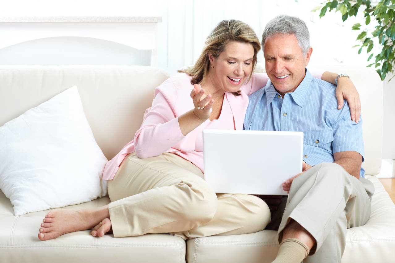 Mature couple learning on a sofa